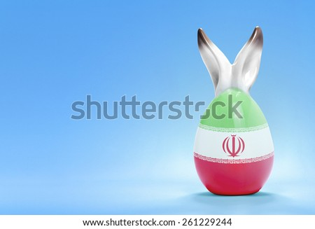 Colorful cute ceramic easter egg with rabbit ears and the flag of Iran .(series) - stock photo