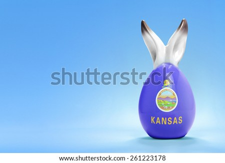 Colorful cute ceramic easter egg with rabbit ears and the flag of Kansas .(series) - stock photo