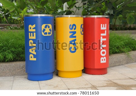 Colorful Cylindrical Bins For Collection Of Recycle Materials - stock photo