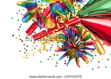colorful decoration with garlands, streamer, cracker, party hats and confetti. festive background - stock photo