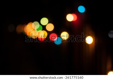 Colorful defocused bokeh lights background. Festive background with natural bokeh. Abstract blur background. - stock photo