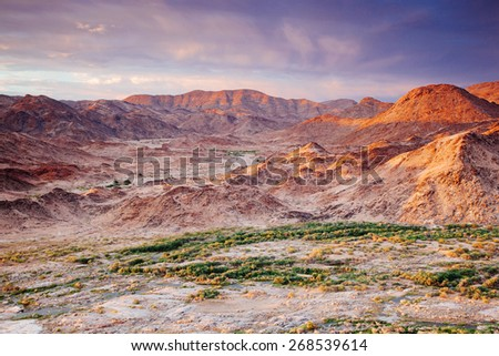 Colorful desert landscape depicting the mountains of Namibia at sunset
