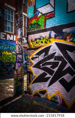Colorful designs in the Graffiti Alley, Baltimore, Maryland. - stock photo