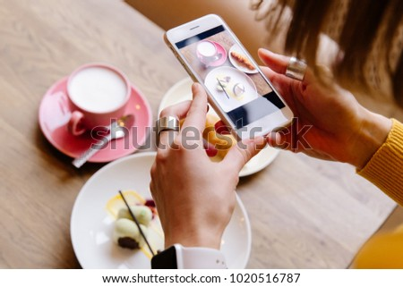 colorful dessert coffee bun with phone and hands