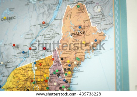 Colorful detail map macro close up with push pins marking locations throughout the United States of America Maine ME  - stock photo