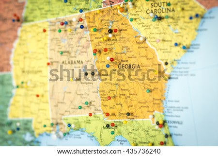 Colorful detail map macro close up with push pins marking locations throughout the United States of America GA Georgia  - stock photo