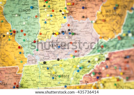 Colorful detail map macro close up with push pins marking locations throughout the United States of America KY Kentucky - stock photo