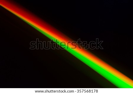 Colorful diagonal stripe is on black background.
