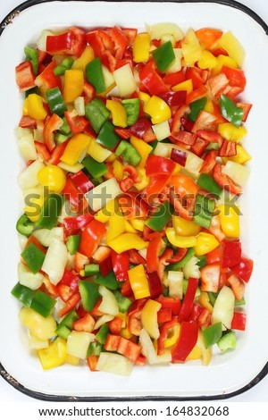 Colorful diced peppers on the metal tray - stock photo