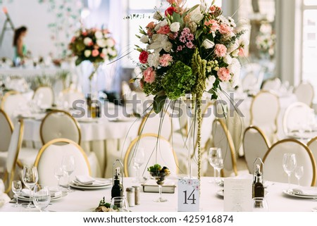 Colorful different flowers in the bouquet on the table - stock photo