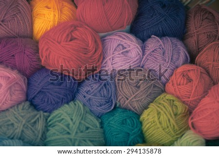 Colorful different wool thread balls. Shot with shallow depth of field - stock photo