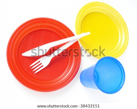 colorful disposable tableware set on white - stock photo