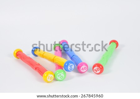 Colorful diving sticks for playing in pool, summer sports and games