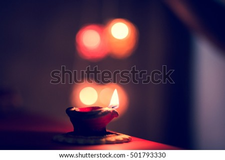 Colorful Diya lamps lit during Diwali celebration