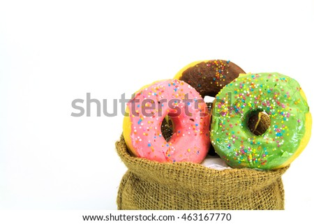 Colorful Donuts in bag on  white background.