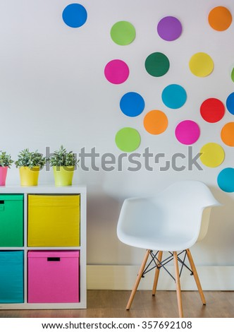 Colorful dots on the wall of child's room - stock photo