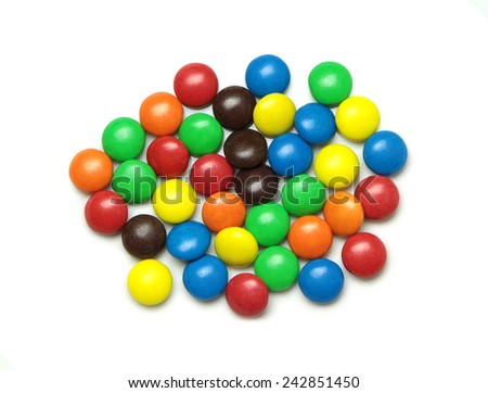 Colorful dragee candies isolated on white background. - stock photo