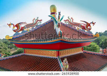 Colorful dragon on roof in public Chinese temple - stock photo