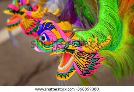 colorful dragon plastic toy for chinese new year happy and goodluck - stock photo