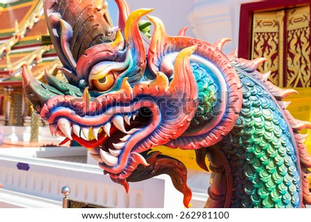 colorful dragon statue in front of buddhist church - stock photo