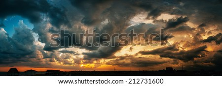 colorful dramatic cloudy sky at sunset - stock photo