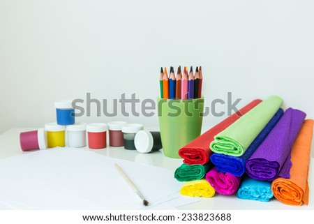 Colorful drawing tools on the white background - stock photo