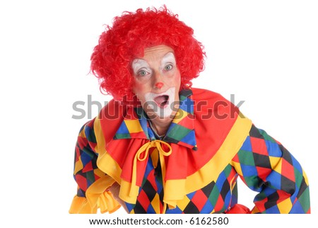 Colorful dressed female holiday clown, happy joyful expression on face, making funny gestures with hands