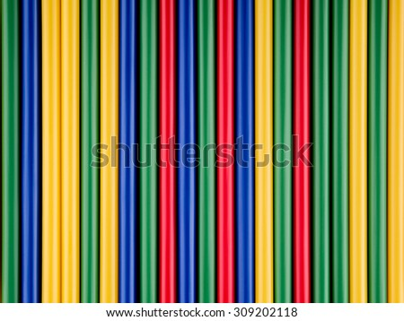 Colorful drinking straws arranged in straight lines