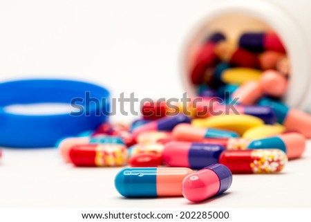colorful drugs and pills shooting in studio - stock photo