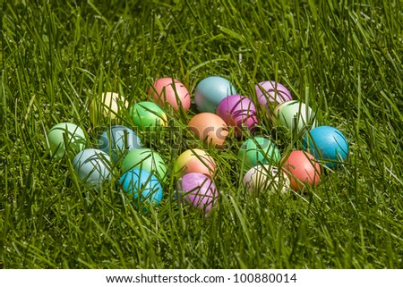 Colorful dyed easter eggs in real grass