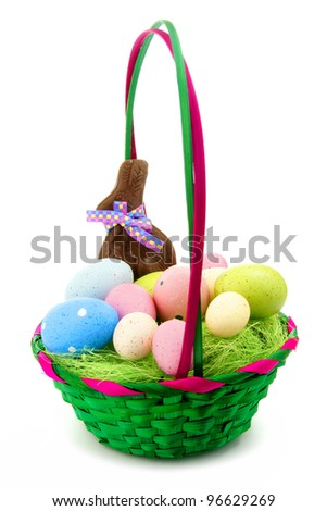 Colorful Easter basket with eggs, candy and chocolate bunny - stock photo