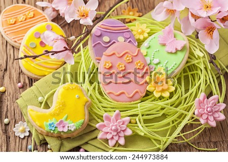 Colorful easter cookies in a nest  - stock photo