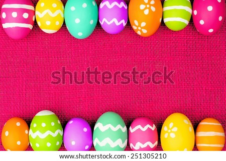 Colorful Easter egg double border over a pink burlap background - stock photo