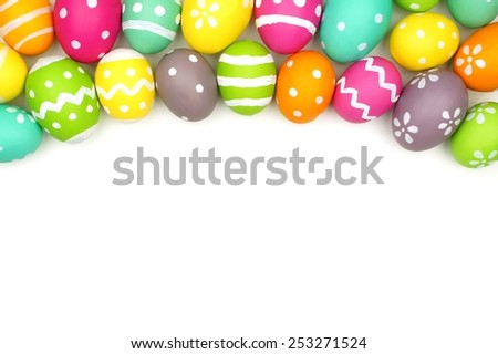 Colorful Easter egg top border against a white background - stock photo