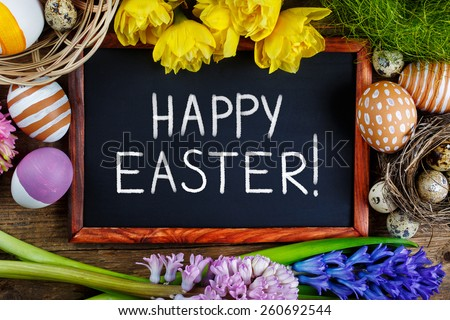 Colorful Easter eggs and Black board with text - Happy Easter.  - stock photo