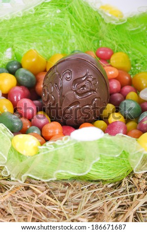 Colorful easter eggs and chocolate egg in a basket