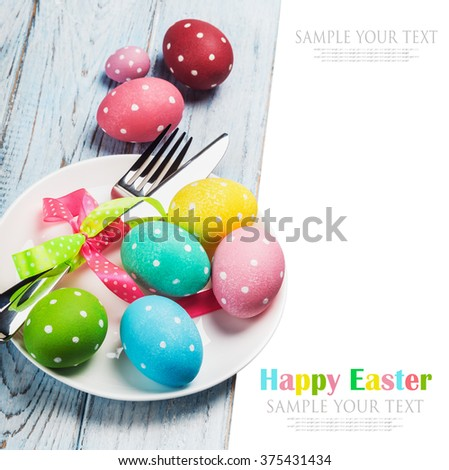 colorful easter eggs and cutlery on a white background. text is an example and removed easily - stock photo