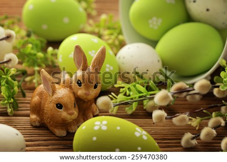 colorful easter eggs and easter rabbits - stock photo