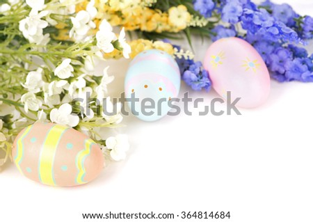 Colorful Easter eggs and flowers on a white background - stock photo