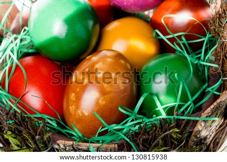 Colorful Easter eggs basket closeup - stock photo
