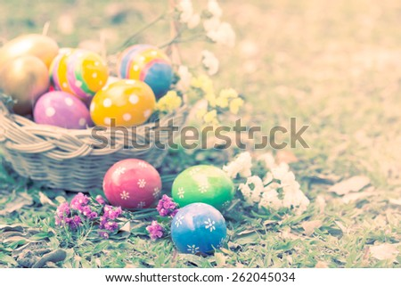 Colorful easter eggs decorate with flower on grass in vintage style - stock photo