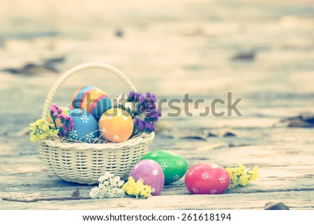 Colorful easter eggs decorate with flower on wooden pathway in vintage style - stock photo