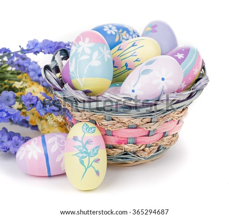 Colorful Easter eggs flowers and basket on a white background