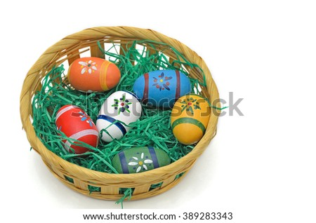colorful Easter eggs in a basket,  close up, isolated on  white background, horizontal / Colorful Easter eggs