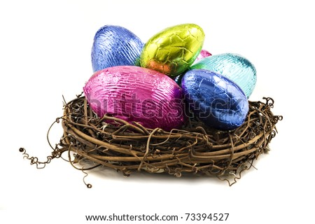 Colorful easter eggs in a nest on a white background - stock photo