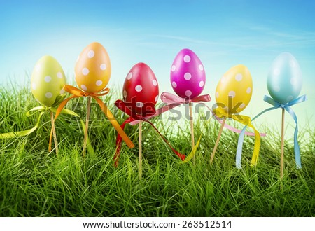 Colorful easter eggs in a row - stock photo