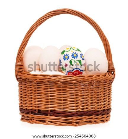 Colorful Easter eggs in a wicker basket isolated on white background - stock photo