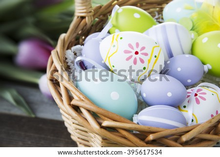 Colorful Easter eggs in basket. - stock photo