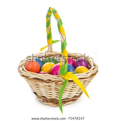 colorful easter eggs in basket isolated - stock photo