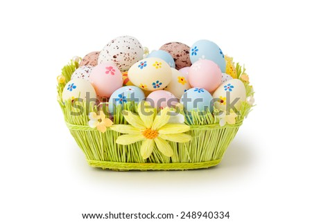 Colorful Easter eggs in basket. Isolated on white background. - stock photo